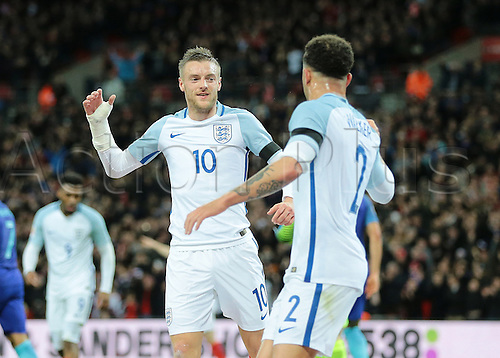 29.03.2016. Wembley Stadium, London, England.  International Football Friendly England versus Netherlands. England Forward Jamie Vardy scores England's first past Netherlands Goalkeeper Jeroen Zoet and celebrates with England Defender Kyle Walker , 1-0 England
