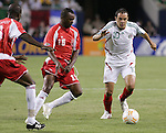21 June 2007:  Mexico's Cuauhtemoc Blanco (10) looks to dribble past Guadeloupe's Jocelyn Angloma (15). The National Team of Mexico defeated Guadeloupe 1-0  in a CONCACAF Gold Cup Semifinal match at Soldier Field in Chicago, Illinois.