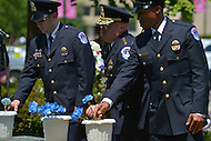 May 10, 2013  (Washington, DC)  U.S. Capitol Police Chief Kim Dine (c) and Capitol Police officers dedicate flowers during a ceremony at the Washington Area Law Enforcement Memorial.  (Photo by Don Baxter/Media Images International)