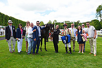 Connections of Initiative in the Winners enclosure after winning The Bathwick Tyres Novice Auction Stakes(plus 10, Div 1), during Afternoon Racing at Salisbury Racecourse on 13th June 2017