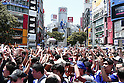 Japanese funs, <br /> Shibuya Scramble crossing after the FIFA World Cup match in Shibuya, Tokyo, Japan. <br /> Japan lost the FIFA World Cup Brazil 2014 Group C match against Cote d'Ivoire.<br /> (Photo by SHINGO ITO/AFLO SPORT) [1195]