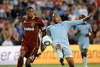 Teal Bunbury (pale blue) Sporting KC forward flicks the ball on watched by Real Salt Lake defender Chris Schuler (28).. Sporting KC defeated Real Salt Lake 2-0 at LIVESTRONG Sporting Park, Kansas City, Kansas.