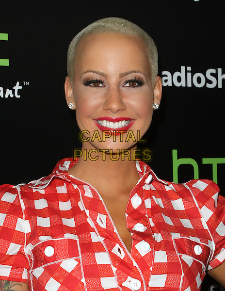 Amber Rose.Radioshack's HTC EVO 3D Launch Party  Held At The RadioShack Pop-Up 3D Lounge, West HollywooD, California, USA, 23rd June 2011..portrait headshot tattoo smiling beauty lipstick red and white checked gingham check playsuit jumpsuit romper .CAP/ADM/KB.©Kevan Brooks/AdMedia/Capital Pictures.