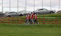 Monday 25 November 2014<br /> Pictured L-R: Nathan Dyer, Ashley Jazz Richards, Ashley Williams and Wilfried Bony walking on the path towards the gym<br /> Re: Swansea City FC training at the club's Fairwood Training Ground in the outskirts of Swansea, south Wales, UK.