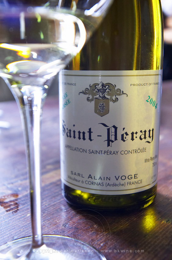 glass and bottle st peray 2004 in cellar dom a voge cornas rhone france