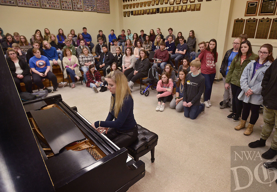 NWA Democrat-Gazette/BEN GOFF @NWABENGOFF<br /> Natasha Paremski, a pianist from New York, plays a Paganini piece for Bentonville High School music students on Friday Jan. 27, 2017 at the school. Paremski played several pieces before taking questions from students at the event, which was part of Symphony of Northwest Arkansas's ongoing community educational outreach. Paremski is in Northwest Arkansas to perform with the symphony at their Masterworks I: 'Momentum' concert at 7:30pm on Saturday at the Walton Arts Center in Fayetteville. Paremski was born in Moscow, Russia and began studying piano at age 4 before moving the United States and becoming a citizen at age 8.