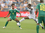 Elliot Bonds (4) of Guyana (left) and Kevin Molino (10) of Trinidad and Tobago vie for the ball during their Gold Cup match on June 26, 2019 at Children's Mercy Park in Kansas City, KS.<br /> Tim VIZER/AFP