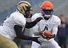 Dante Lacroix #4 of Malverne, right, hands off to John Debique #8 of Baldwin during the Nassau County Senior Bowl, pitting the all-stars of Conferences I and IV (White Team) against their Conferences II and III (Blue Team) counterparts at Mitchel Athletic Complex on Thursday, Nov. 24, 2016.