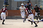 Western Nevada Wildcats' Madi Gonzalez bunts against North Idaho College at Edmonds Sports Complex, in Carson City, Nev., on Friday, April 18, 2014.<br /> Photo by Cathleen Allison/Nevada Photo Source