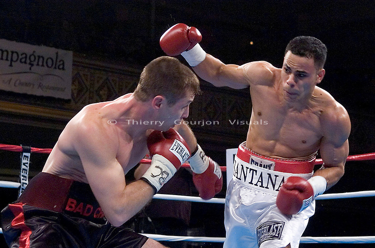 Edgar Santana (white) on the attack against Chad Lawshe during their 8 rounds Junior Welterweight Fight at the Hammerstein ballroom in New York City on Feb. 24, 2005..Santana won by 2nd round TKO.