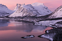 Colorful winter sunset over Bergsfjord, Senja, Norway