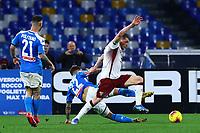 29th February 2020; Stadio San Paolo, Naples, Campania, Italy; Serie A Football, Napoli versus Torino; Andrea Belotti of Torino FC  cwins the ball from Giovanni Di Lorenzo of Napoli