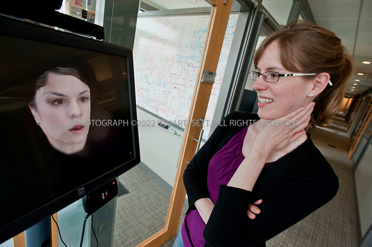 """6/16/2010--Redmond, WA, USA..Anne Loomis, Research Software Development Engineer, Microsoft Research, shown here interacting with """"Diane,"""" a computational personal assistant that sits outside Eric Horvitz's office to help manage his schedule and to coordinate his activities with others...©2010 Stuart Isett. All rights reserved."""