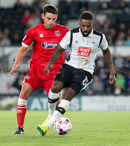 09.08.2016. iPro Stadium, Derby, England. Football League Cup 1st Round. Derby versus Grimsby Town. Derby County striker Darren Bent on the ball closely followed by Grismby Town defender Shaun Pearson.
