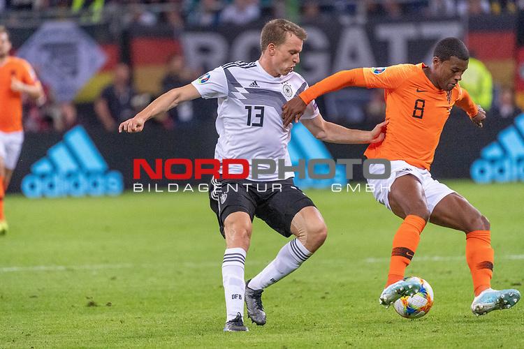 06.09.2019, Volksparkstadion, HAMBURG, GER, EMQ, Deutschland (GER) vs Niederlande (NED)<br /> <br /> DFB REGULATIONS PROHIBIT ANY USE OF PHOTOGRAPHS AS IMAGE SEQUENCES AND/OR QUASI-VIDEO.<br /> <br /> im Bild / picture shows<br /> Georginio WIJNALDUM (Niederlande / NED #08) <br /> Lukas Klostermann (Deutschland / GER #13)<br /> <br /> <br /> während EM Qualifikations-Spiel Deutschland gegen Niederlande  in Hamburg am 07.09.2019, <br /> <br /> Foto © nordphoto / Kokenge