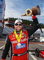 Jun 19, 2016; Bristol, TN, USA; NHRA top fuel driver Shawn Langdon celebrates after winning the Thunder Valley Nationals at Bristol Dragway. Mandatory Credit: Mark J. Rebilas-USA TODAY Sports
