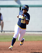 Michigan Wolverines Softball outfielder Sierra Lawrence (22) runs the bases during a game against the Bethune-Cookman on February 9, 2014 at the USF Softball Stadium in Tampa, Florida.  Michigan defeated Bethune-Cookman 12-1.  (Copyright Mike Janes Photography)