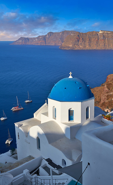 Traditional blue domed Greek Orthodox church of Oia, Island of Thira, Santorini, Greece.