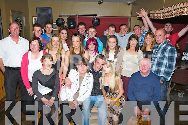 KEY OF THE DOOR: Shane Fitzgerald from Ardfert who celebrated his 21st on Saturday night in McElligotts Bar, Ardfert, with his family and friends (Shane is seated centre).