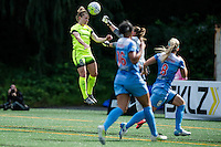 Seattle, WA - Sunday, May 22, 2016: Seattle Reign FC midfielder Kim Little (8) goes up for a header as Chicago Red Stars goalkeeper Alyssa Naeher (1) attempts to clear during a regular season National Women's Soccer League (NWSL) match at Memorial Stadium.