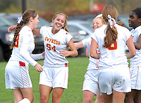 LOWER GWYNEDD, PA -  OCTOBER 23: Gwynedd Mercy Academy team members celebrate the after scoring the first goal of the game against Lower Moreland during a District One Class AA playoff game October 23, 2013 in Lower Gwynedd, Pennsylvania. Gwynedd Mercy Academy defeated Lower Moreland 5-1. (Photo by William Thomas Cain/Cain Images)