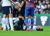 5th November 2017, Wembley Stadium, London England; EPL Premier League football, Tottenham Hotspur versus Crystal Palace; Harry Kane of Tottenham Hotspur being treated on the pitch after receiving a hard tackle by Timothy Fosu-Mensah of Crystal Palace