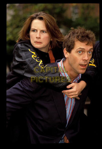 JENNIFER SAUNDERS & HUGH LAURIE.Jennifer Saunders Archive.Ref:Hugh Thompson.half length with together piggy back arms around shoulders funny funnies expression.sales@capitalpictures.com.www.capitalpictures.com.©Capital Pictures..
