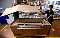 BOGOTA, COLOMBIA - MAY 14: Workers assemble a hospital bed which in case to be needed can be used as a coffin in Bogota, May 14, 2020. The bed was designed by a Colombian company for COVID-19 patients amid the new coronavirus pandemic that infected 12.930 people and claimed 509 lives in the country. (Photo by Leonardo Munoz/VIEWpress)