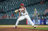 Arkansas Razorbacks relief pitcher Elijah Trest (20) in action against the Baylor Bears in game nine of the 2020 Shriners Hospitals for Children College Classic at Minute Maid Park on March 1, 2020 in Houston, Texas. The Bears defeated the Razorbacks 3-2. (Brian Westerholt/Four Seam Images)