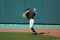 West Virginia State Yellow Jackets right fielder Brendan Quinn (5) throws the ball back to the infield during the game against the Catawba Indians at Newman Park on February 9, 2020 in Salisbury, North Carolina. The Indians defeated the Yellow Jackets 15-9 in game one of a doubleheader.  (Brian Westerholt/Four Seam Images)
