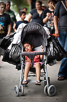 Ashley Perez (cq, 2) sits in a stroller surrounded by shopping bags during a shopping outing with her family in the downtown area of McAllen, Texas, Saturday, April 3, 2010. Downtown McAllen stores don't sell designer or name brand items, but still reach a wide customer base for McAllen residents and visiting Mexican tourists. ...PHOTO/ Matt Nager