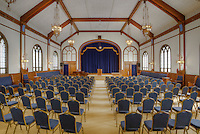 Auditorium set for presentationin aging meeting hall.  Dating to 1927, the Masonic Retirement Center, locally known as the Masonic Home, in Des Moines, Washington is now an elegant event center available for rental.  In the historic Zenith neighborhood of the city of Des Moines. Please conact douglasorton@comcast.net regarding licensing of this image.