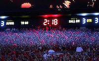 A weird color cast from the scoreboard illuminates the fans in the south stands during the second half of the game between Ohio State and Wisconsin at Ohio Stadium on Saturday, September 28, 2013. (Columbus Dispatch photo by Jonathan Quilter)
