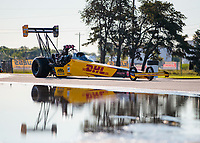 Jul 12, 2020; Clermont, Indiana, USA; The dragster of NHRA top fuel driver Shawn Langdon reflects in a puddle during the E3 Spark Plugs Nationals at Lucas Oil Raceway. This is the first race back for NHRA since the start of the COVID-19 global pandemic. Mandatory Credit: Mark J. Rebilas-USA TODAY Sports