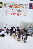 Jessie Royer and team leave the ceremonial start line at 4th Avenue and D street in downtown Anchorage during the 2013 Iditarod race. Photo by Jim R. Kohl/IditarodPhotos.com