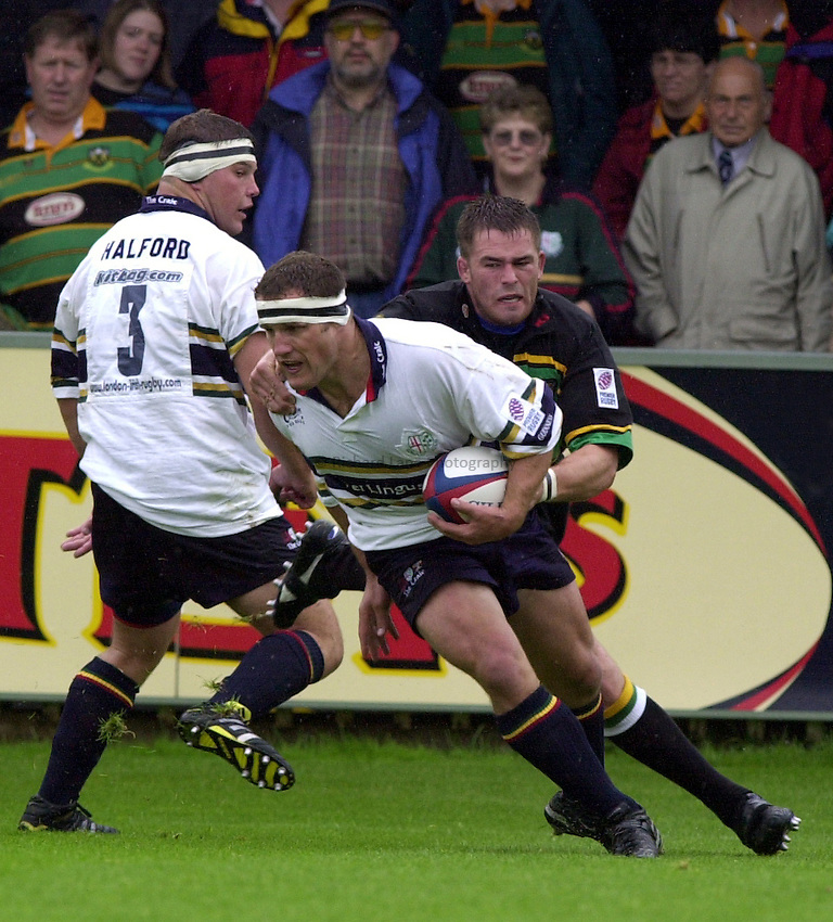 Photo. Richard Lane. .Northampton v London Irish. Zurich Premiership. 26/8/2000..Richard Kirke is held by Grant Seely.