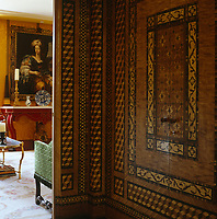 Wall panels decorated with faux marquetry in this corridor conceal cupboards in which dishes and glasses are stored