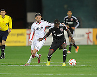 Washington D.C. - April 5, 2014:  Eddie Johnson of D.C. United shields the ball against Lee Nguyen from the New England Revolution.  D.C. United defeated 2-0 the New England Revolution during a Major League Soccer match for the 2014 season at RFK Stadium.