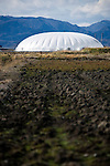 "Photo shows one of the vegetable ""factory"" domes inside the Minamisoma Agri-Solar Park in Minamisoma, Fukushima, Japan on 10 Feb 2013. More than 2,000 solar panels will power the domes, inside which farmers affected by the 2011 tsunami and nuclear accident will be able to grow produce. Excess power will be sold to a local utilities company. .Photographer: Robert Gilhooly"
