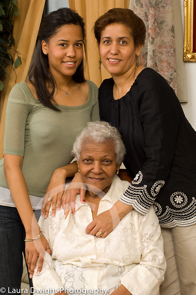 three female generations of one family maternal grandmother, mother in 40s, and teenage daughter, age 18 Dominican-American