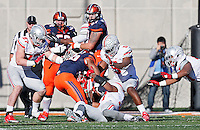 Ohio State Buckeyes linebacker Joshua Perry (37) and the defense stop Illinois Fighting Illini running back Cameron Tucker (26) on a fourth down in the red zone in the third quarter of the college football game between the Ohio State Buckeyes and the Illinois Fighting Illini at Memorial Stadium in Champaign, Ill., Saturday morning, November 14, 2015. The Ohio State Buckeyes defeated the Illinois Fighting Illini 28 - 3. (The Columbus Dispatch / Eamon Queeney)