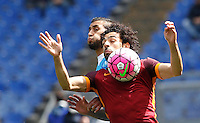 Calcio, Serie A: Roma vs Napoli. Roma, stadio Olimpico, 25 aprile 2016.<br /> Roma's Mohamed Salah, right, controls the ball as he is challenged by Napoli's Faouzi Ghoulam during the Italian Serie A football match between Roma and Napoli at Rome's Olympic stadium, 25 April 2016.<br /> UPDATE IMAGES PRESS/Riccardo De Luca