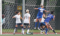 Boston Breakers midfielder Mariah Noguiera (20) header scores on corner kick.Seattle Reign FC defender Lauren Barnes (3), Boston Breakers forward Kyah Simon (17), Seattle Reign FC goalkeeper Hope Solo (1). In a National Women's Soccer League (NWSL) match, Seattle Reign FC (white) defeated Boston Breakers (blue), 2-1, at Dilboy Stadium on June 26, 2013.