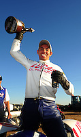 Oct. 16, 2011; Chandler, AZ, USA; NHRA pro stock motorcycle rider Hector Arana Jr celebrates after winning the Arizona Nationals at Firebird International Raceway. Mandatory Credit: Mark J. Rebilas-