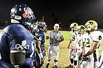 Lawndale, CA 10/21/11 - Tommy Webster (Peninsula #49), Alejandro Garcia (Peninsula #84), Ken Martin (Peninsula #22), Joey Augello (Peninsula #58) and unidentified Leuzinger player(s) in action during the Peninsula - Leuzinger varsity football game.