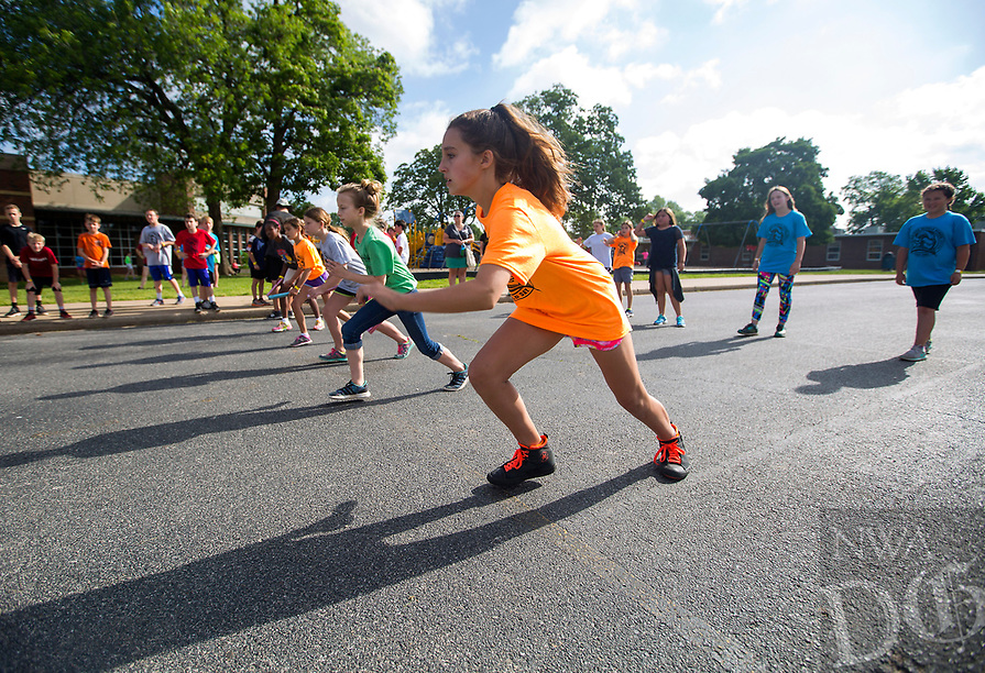 NWA Democrat-Gazette/JASON IVESTER<br /> Bridget Wise, fifth-grader, takes off to start the 4x400 race Thursday, May 18, 2017, during the Fun and Field Day at Old High Middle School in Bentonville. Next Friday is the last day of school for Bentonville students.