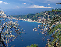 Italy, Sicily, view from Taormina at resort Giardini-Naxos and volcano Etna
