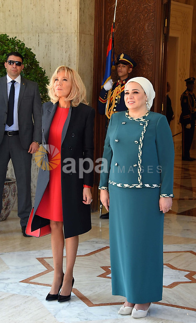 Egyptian First Lady Intissar Amer (R) and Brigitte Macron (L), wife of French President, posing for a picture at the presidential palace in Cairo on January 28, 2019. Photo by Egyptian President Office