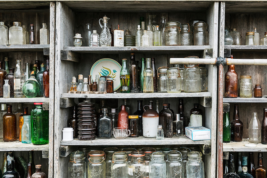 Old bottle display at an antique shop, Maine, USA.