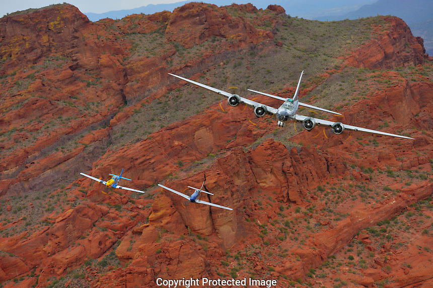 Boeing B-17 Bomber & P-51 Mustangs pass over Arizona's desert.